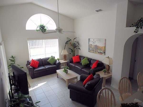 Lounge with leather sofa, love seat and chair.