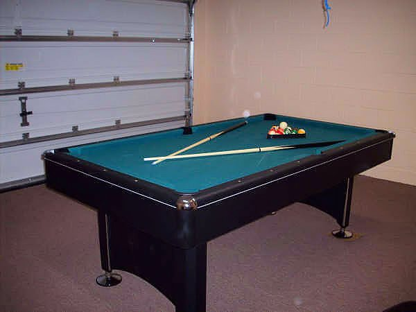 Arcade quality pool table in the games room
